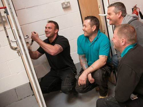 Trainer teaching a locksmith training course