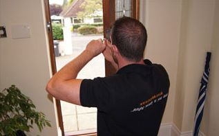 Accredited locksmith changing a nightlatch