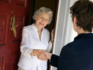 local Keytek locksmith greets customer at front door
